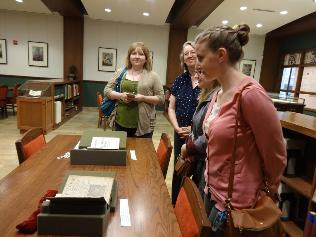SLIM students admiring 16th century science books