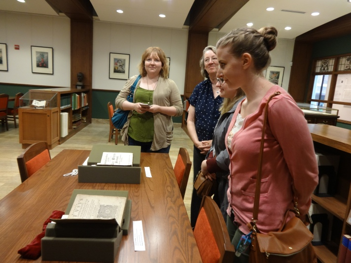 SLIM students admiring 16th century science books